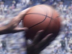 Hands Grabbing a Basketball