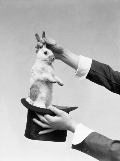 Hands of Magician Performing Magic Trick, Pulling Rabbit Out of Top Hat-H^ Armstrong Roberts-Photographic Print