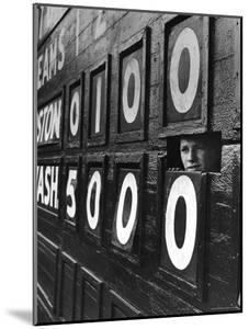 Boy Running Scoreboard at Griffith Stadium During the Baseball Game by Hank Walker