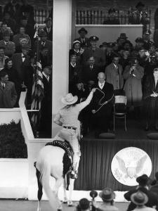 Inauguration of President Dwight Eisenhower, Approached by a Parade Cowboy who Lassoes Him by Hank Walker