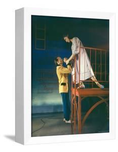 """Larry Kert and Carol Lawrence in Fire Escape Scene from """"West Side Story."""" by Hank Walker"""
