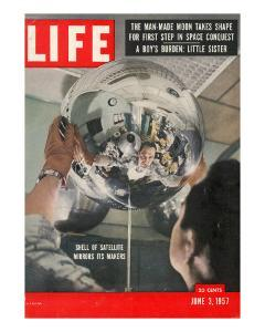 Naval Research Lab Worker Examining Shell of a Satellite, June 3, 1957 by Hank Walker