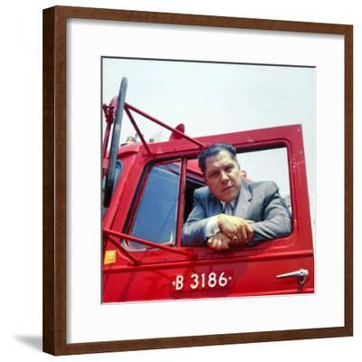 Portrait of Teamsters Union Pres. Jimmy Hoffa Leaning Out Window of Red Truck