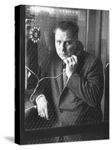 President of Teamsters Union Jimmy Hoffa Making Phone Call from Glassed-In Phone Booth by Hank Walker