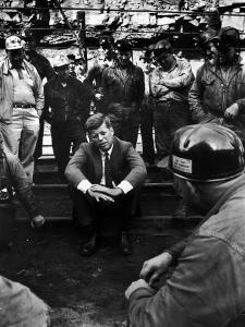 Presidential Candidate, Sen. John Kennedy Chatting with Miners, Campaigning During Primaries by Hank Walker