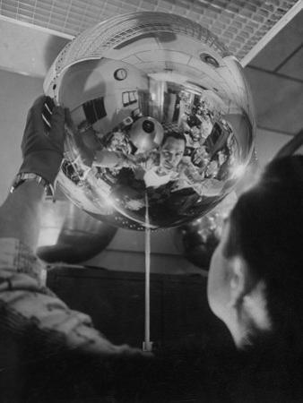 Scientist Alexander Simkovich Working on a Us Artificial Satellite