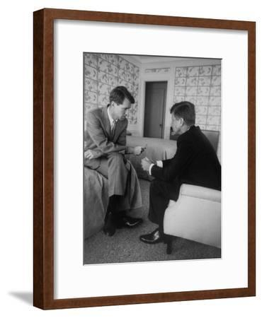 Senator John F. Kennedy and Brother Robert F. Kennedy Conferring in Hotel Suite During Convention