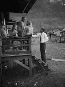 Senator John F. Kennedy Greeting Rural Family While Campaigning For President by Hank Walker