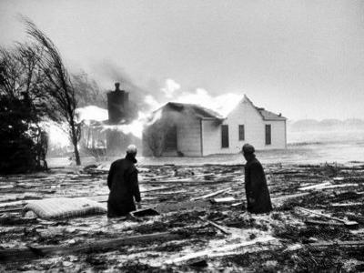 Two People Watching House Burn in Aftermath of Hurricane Hazel