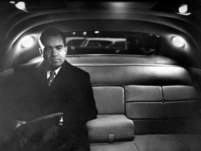 VP Richard Nixon Sitting Solemnly in Back Seat of Dimly Lit Limousine