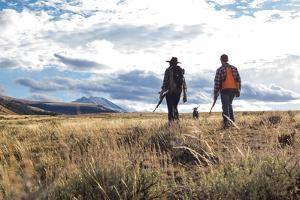 Couple Hikes While Bird Hunting In Montana With Their German Shorthaired Pointer Dog by Hannah Dewey