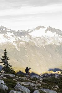 Lone Man Backpacks Down A Ridge In The North Cascades To His Camp-Site In Washington by Hannah Dewey