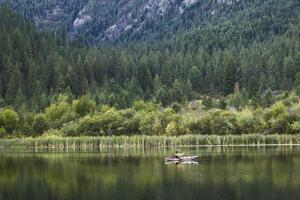 Man Fly-Fishes Out Of His Kayak On Fish Lake Outside Of Conconully, Washington by Hannah Dewey