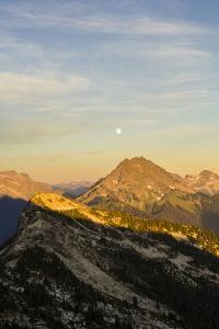 Moonrise And Sunset Over The North Cascade Mountain Range In Washington During Summer by Hannah Dewey