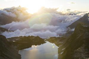 Morning Sunrise Over An Alpine Lake In The North Cascades Of WA During A Summer Backpacking Trip by Hannah Dewey