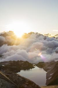 Morning Sunrise Over An Alpine Lake In The North Cascades Of Washington During Summer by Hannah Dewey