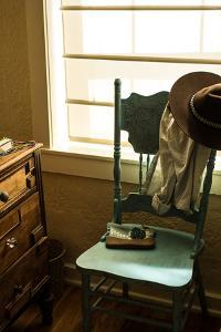 Vignette Of Womans Clothing And Jewelry Draping A Turquoise Chair In A Southwest Home In New Mexico by Hannah Dewey