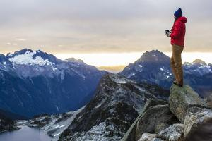 Woman Drinks Her Coffee On Top Of A Mountain In The Morning Looking Out Into The Cascade Mts In WA by Hannah Dewey