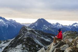 Woman Drinks Her Morning Coffee On A Mountain Top In North Cascades National Park, Washington by Hannah Dewey