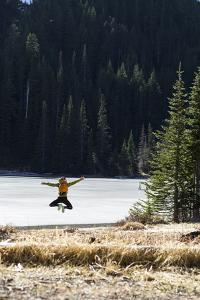 Woman Jumps Up In Joy After Reaching A Beautiful High Alpine Lake In The Olympic Mountains, Wa by Hannah Dewey