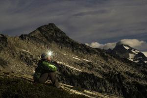 Woman Sits On The Side Of A Mountain Looking Up At The Stars In The North Cascades, Wa by Hannah Dewey