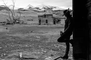 Woman Takes A Drink Of Whiskey From Her Flask In An Old Abandoned Barn In Rural Montana by Hannah Dewey