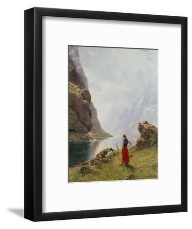 A Girl with Goats by a Fjord