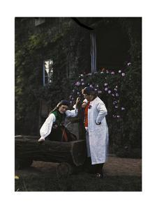 A Couple Poses Next to a Water Fountain in a Gaden in Swabian Clothes by Hans Hildenbrand