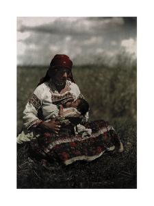 A Gypsy Woman Nurses Her Child by Hans Hildenbrand