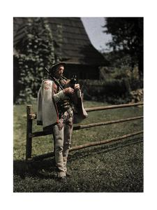 A Man Plays a Bag Pipe by Hans Hildenbrand