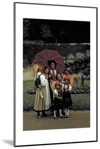 A Peasant Family Poses under an Umbrella at a Folk Costume Festival by Hans Hildenbrand