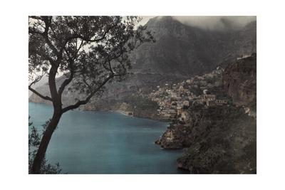 A View of a Small Town Tucked into the Mountain Near Amalfi