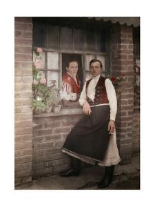 A Young Couple in Costume Visit Through an Open Window by Hans Hildenbrand