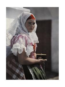 A Young Woman of Sopron Wears a Tight-Fitting Red Cap under Her Shawl by Hans Hildenbrand