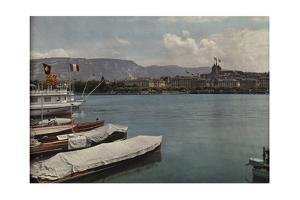 Boats are Docked on Lake Geneva across from the Cathedral St. Pierre by Hans Hildenbrand