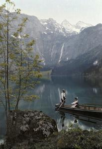 Man and Woman Row in a Boat on the Obersee Lake Near the Mountains by Hans Hildenbrand