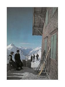 People with Skis Stand Beside the Terrace of the Ulmer Hutte by Hans Hildenbrand