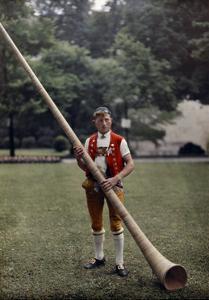 Swiss Man Stands with an Alphorn Instrument by Hans Hildenbrand