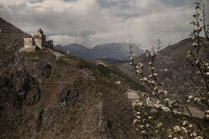 The Castle Karneid Sits Alone Atop The Cliffs Outside Bolzano, Italy by Hans Hildenbrand