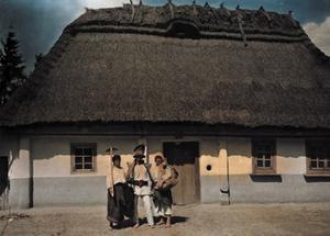Three People Stand in Front of a House after Returning from Work by Hans Hildenbrand