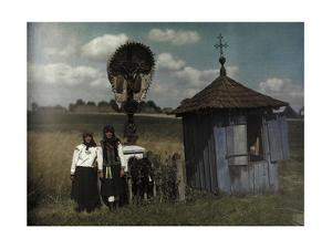 Two Women Stand Beside a Roadside Shrine by Hans Hildenbrand