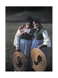 Two Young Women Pose Holding Hats and Smiling by Hans Hildenbrand