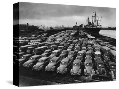Volkswagen Beetles Lined Up on the Dock