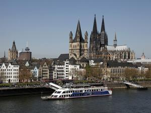 Church of Great Saint Martin and Cathedral, Seen across the River Rhine, Cologne, North Rhine Westp by Hans Peter Merten