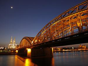 Hohenzollern Bridge over the River Rhine and Cathedral, Cologne, North Rhine Westphalia, Germany, E by Hans Peter Merten