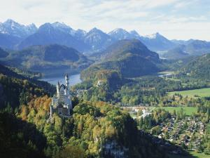 Neuschwanstein and Hohenschwangau Castles, Alpsee and Tannheimer Alps, Allgau, Bavaria, Germany by Hans Peter Merten