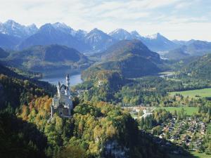 Neuschwanstein and Hohenschwangau Castles, Alpsee and Tannheimer Alps, Allgau, Bavaria, Germany by Hans Peter Merten