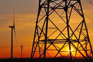 Windmills, pylon and power lines in morning light, Germany, Europe by Hans-Peter Merten