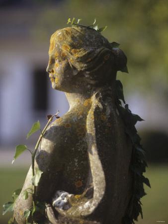 A Stone Statue in a Castle Garden