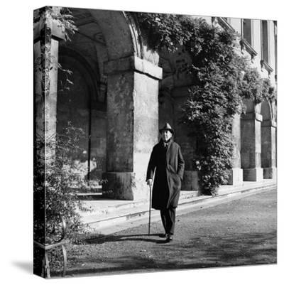 Scholar C.S. Lewis Walking with Cane Near Building at Magdalen College, Oxford University
